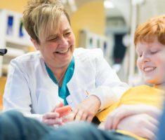 staff and patient Larson Orthodontics Alexandria VA smilesbylarson.com217 235x200 - We Are Here For YOU