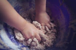 child hands in baking dough P934NJN 300x200 - Child hands in baking dough